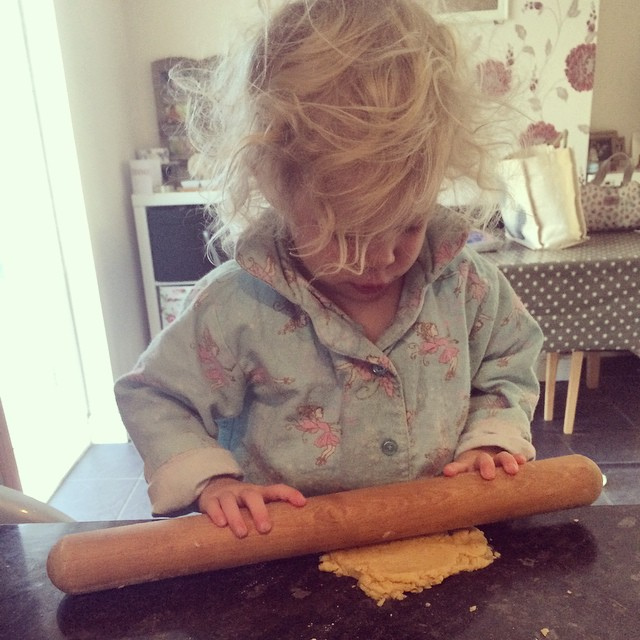 Rolling out her cookie dough #lifeskills #baking #cookies #roll #dough #toddler