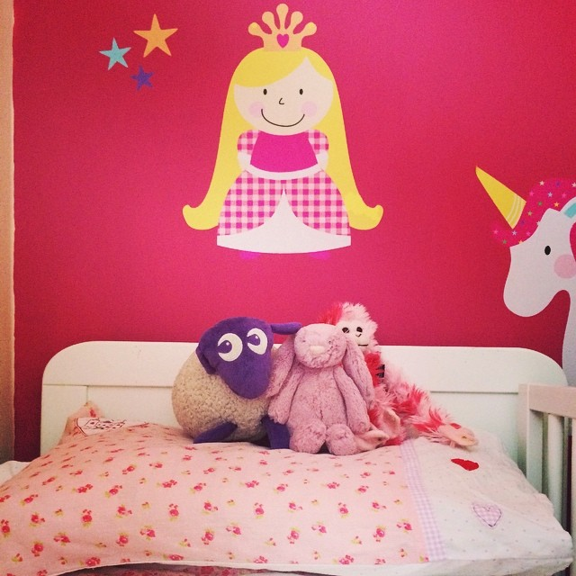 A bed fit for a princess, I think she makes for a good headboard! #toddlers #bedroom #bed #princess #pink