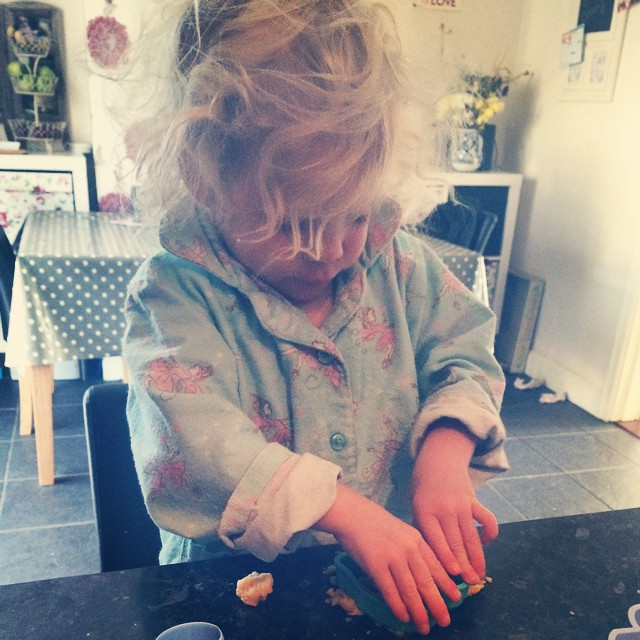 Cutting out her cookie shapes in her nicely rolled dough #cookie #dough #cutters #disney #toddler