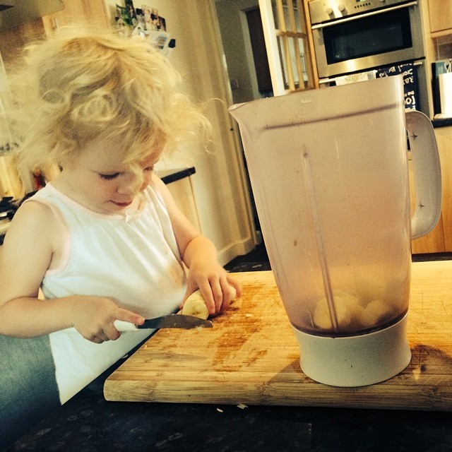 My little big girl chopping up the #narnas (banana) to go in the smoothie #breakfast #toddler