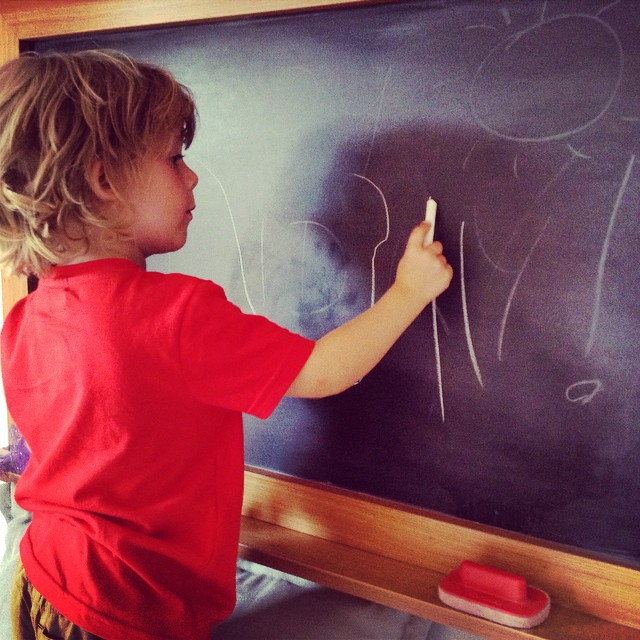 Noah loves drawing on the blackboard in the suites at #holidayvillageturkey great idea!