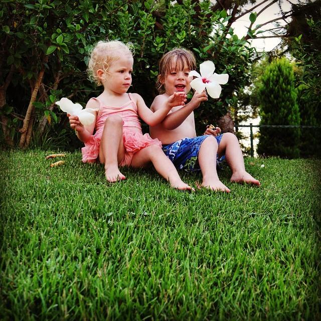 My beautiful babies admiring the flowers #garden #flowers #siblings #holiday