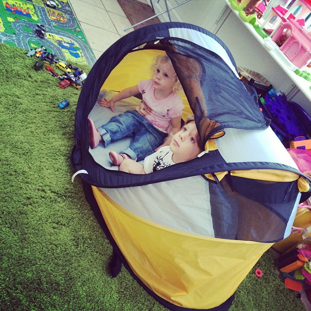 They're camping in the playroom, watching Turbo, in their cool tent! #travelessentials