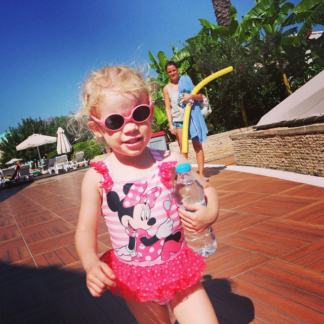 Oh yes this princess is cool and looking after her hydration! Haha #toddler #shades #minniemouse #tutu #holiday