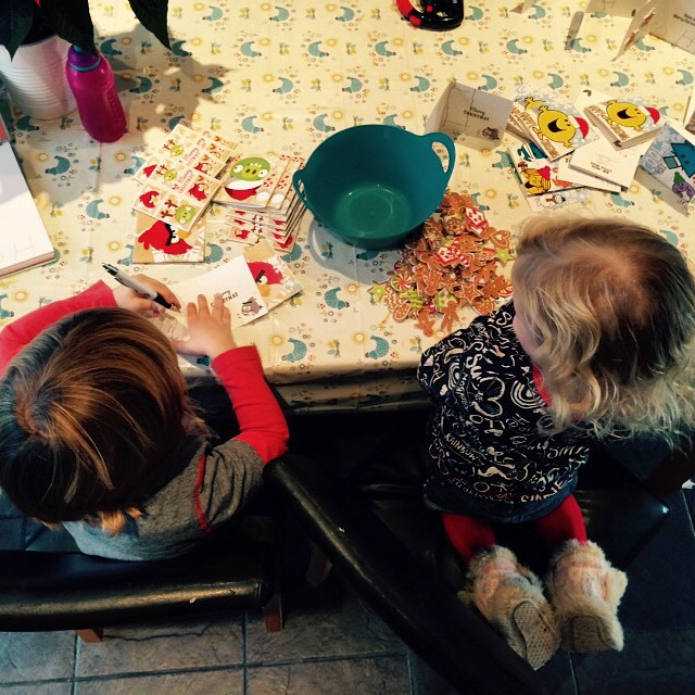 We have a good little production line going... Noah's writing his name and Isla's  sticking her Christmas stickers down... #awesome #teamwork #Christmas #family