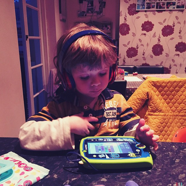 Noah loved sitting in the quiet playing on his #leappad with his headphones ? #growingup