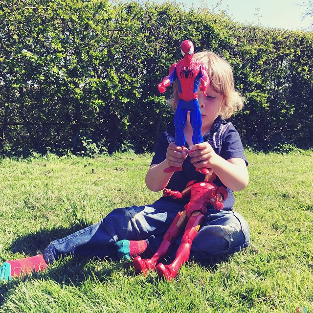 Ironman is giving Spider-Man a shoulder ride! #fungames with our #picnic #lunch in the garden ☺️ #disneystore #marvel